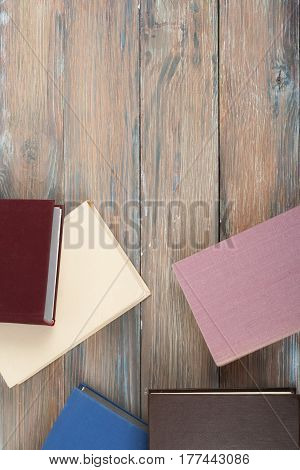 Open book hardback books on wooden table. Back to school. Copy space for text