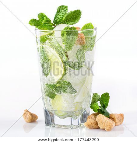 Mojito cocktail with lime and mint on a white background