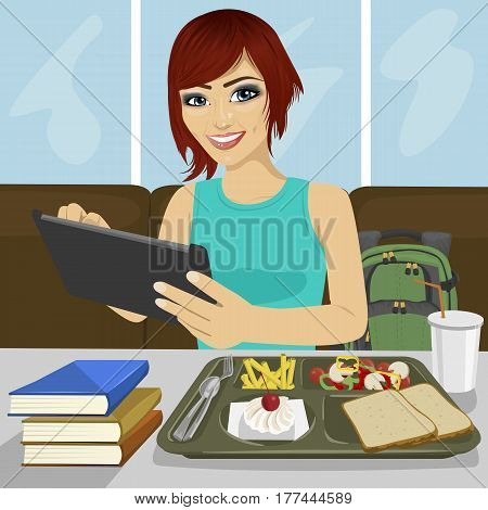 student girl using computer tablet sitting in fast food restaurant