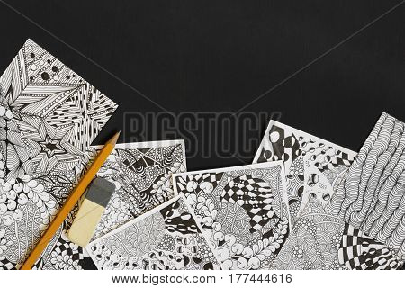 Doodle zen tangle illustration. Zen art doodle patterns for the beginners. Sketch illustrations a pencil and eraser on the dark wooden table. Lesson for artist painters. Place for text copy space