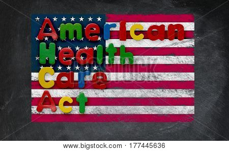 Childs magnetic letters spell American Health Care Act in congress. This is superimposed on a US flag chalked onto a blackboard