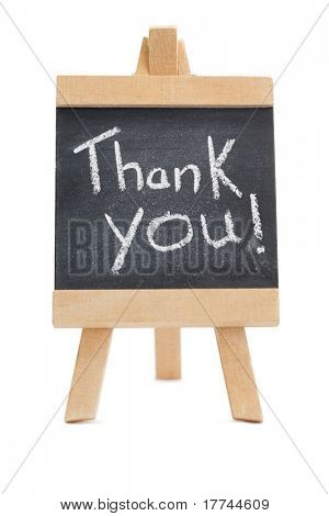 Chalkboard with the words thank you written on it isolated against a white background