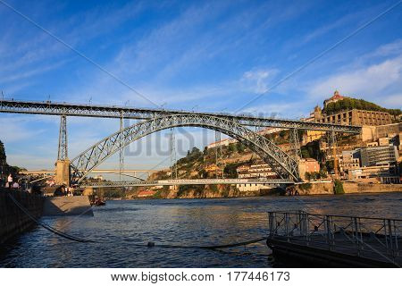 OPORTO, PORTUGAL - 18 AUGUST 2011: View of famous Dom Louis I bridge over Douro River in Oporto, Portugal