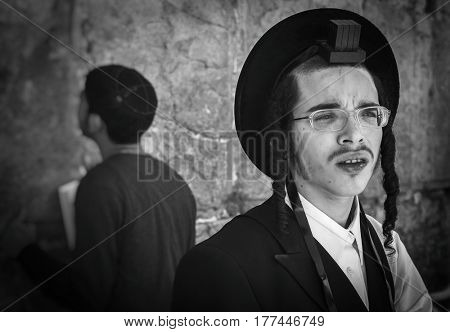 JERUSALEM, ISRAEL - MARCH 06, 2017: The ultra-orthodox Judas Hasid at the Wailing Wall in the Old City