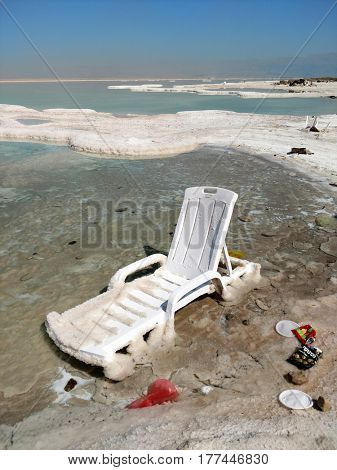 EIN BOCKES (DEAD SEA), ISRAEL - MARCH 08, 2017: Bad ecology. Garbage and dirt on the public beach