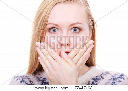 Face expression human emotions concept. Shocked and surprised young blonde woman covering mouth with her hand.