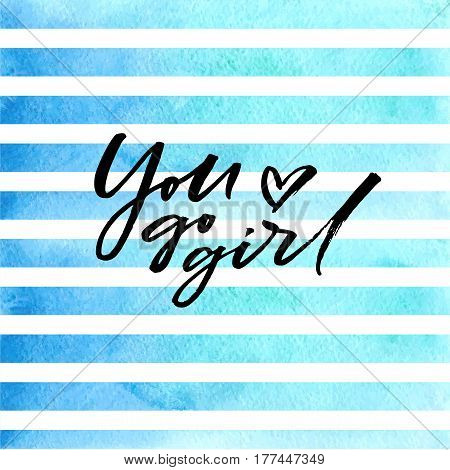 Brush ink lettering You go girl on blue watercolor stripes
