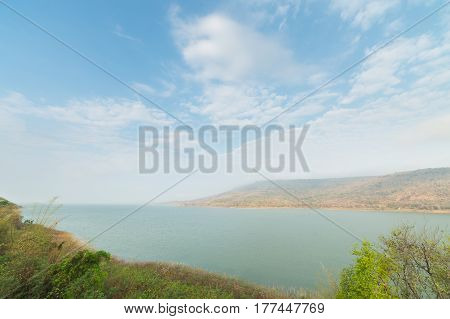 Mountains reservoir lake at Lamtakhong Dam Nakhon Ratchasima Province Thailand Natural of mountain and dam and blue sky
