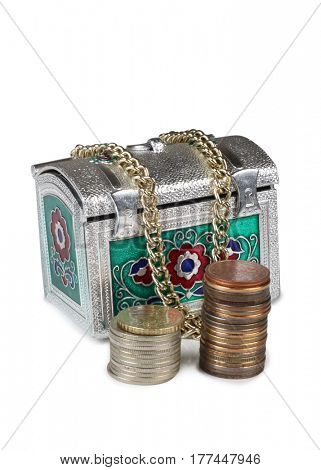 Metal chest and gold coins on white background