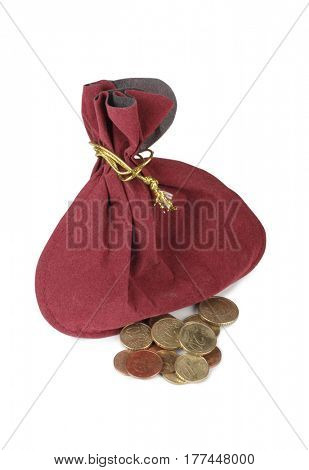 Velvet pouch and gold coins on a white background