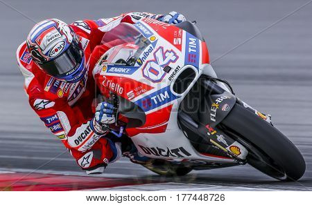SEPANG MALAYSIA - JANUARY 30 2017 : Ducati Team rider Andrea Dovizioso taking a corner during 2017 MotoGP pre-season test at the Sepang International Circuit.