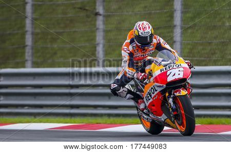 SEPANG MALAYSIA - JANUARY 30 2017 : Repsol Honda Team rider Dani Pedrosa brakes before taking a corner taking a corner during 2017 MotoGP pre-season test at the Sepang International Circuit.