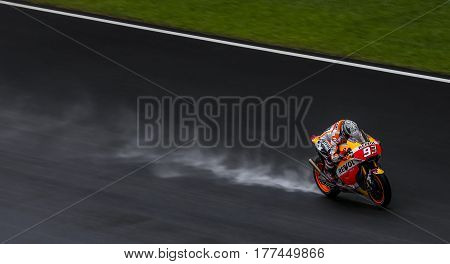 SEPANG MALAYSIA - JANUARY 30 2017 : Repsol Honda Team rider Marc Marquez powers his bike on the wet track during 2017 MotoGP pre-season test at the Sepang International Circuit.