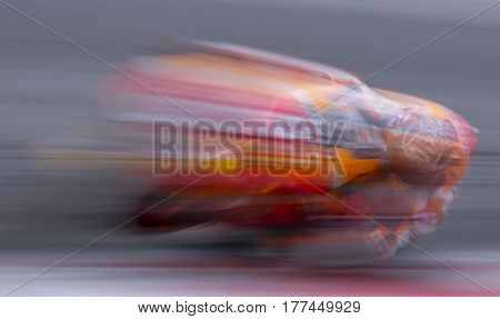 SEPANG MALAYSIA - JANUARY 30 2017 : Motion effect of Repsol Honda Team rider Marc Marquez taking a corner during 2017 MotoGP pre-season test at the Sepang International Circuit.