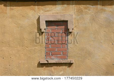 Detail of a bricked up window on a facade