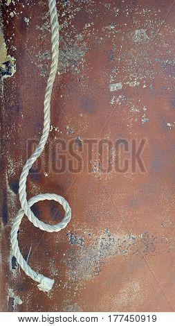 hanging rwhite rope on corrosive metal surface