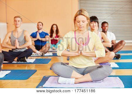 Yoga group during meditation making a breathing exercise