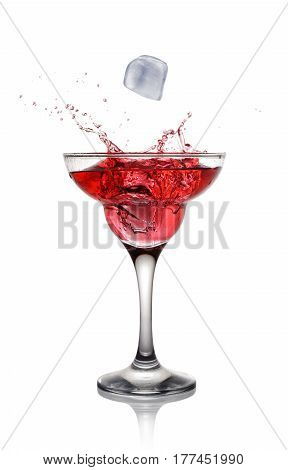 Splash In Glass Of A Pink Alcoholic Cocktail Drink With Ice