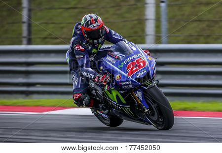 SEPANG MALAYSIA - JANUARY 30 2017 : Movistar Yamaha MotoGP rider Maverick Vinales brakes before taking a corner during 2017 MotoGP pre-season test (Winter Test) at the Sepang International Circuit.