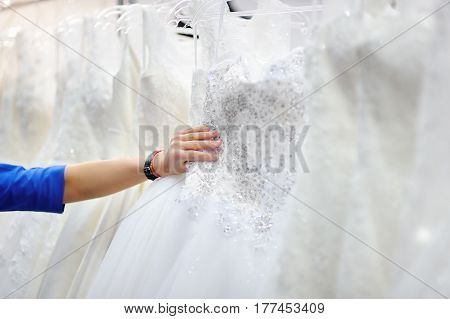 Young Woman Choosing The Perfect Bridal Dress During Bridal Shopping