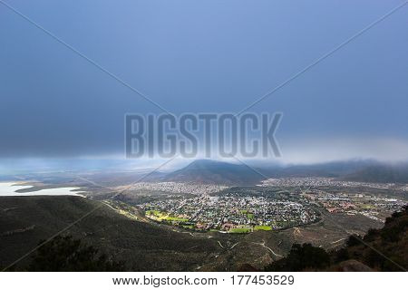 Valley of Desolation viewpoint view of the city of Graaff Reinet during a storm South Africa