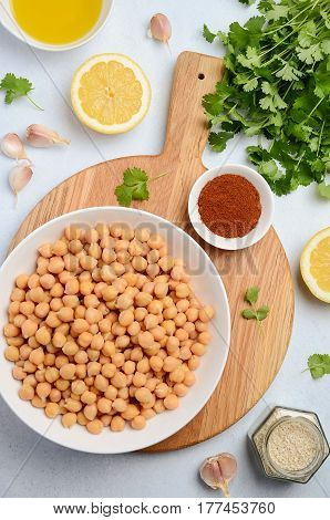 Ingredients for making hummus, top view, vertical.