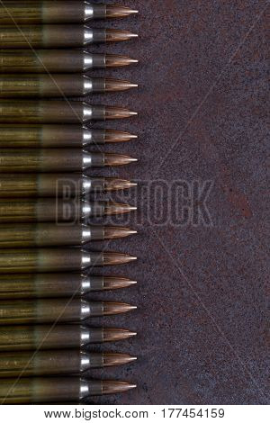 Group of  ammunition on a rusted metal background