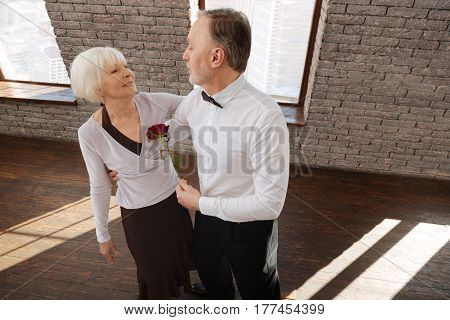 Expressing my love to you. Charismatic lovely skilled dance couple tangoing in the dance studio while demonstrating dance skills and expressing love