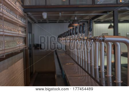 beer drink alcohol beer dispenser in pub club restaurant for bartender ready to be served / beer drink