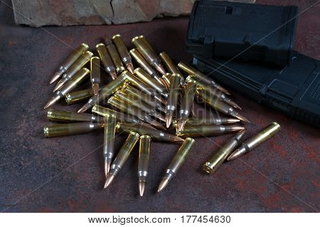 ammunition and magazines 223 rem on a rusted metal background selective focus