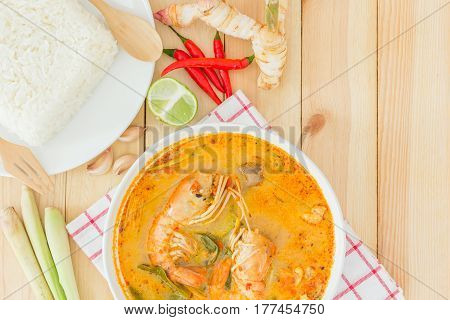 Tom yam kong or Tom yum Tom yam is a spicy clear soup typical in Thailand and No.1 Thai Dish Cuisine Top view with copy space and text