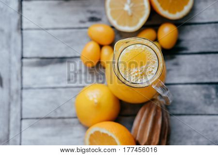 Healthy Food: Kumquat In A White Bowl, Oranges, Lemons And Fresh Juice Squeezer On Wooden Board.