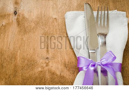 Spring Festive Table Setting With Napkin and Cutlery on Wooden Table. Holidays background. Selective Focus.