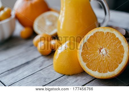 Mixed Citrus Fruits Sliced Oranges, Lemons Kumquat  And Fresh Juice Squeezer On Wooden Board.
