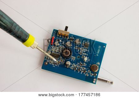 Soldering of tin of electronic componentzs on printed circuit board.
