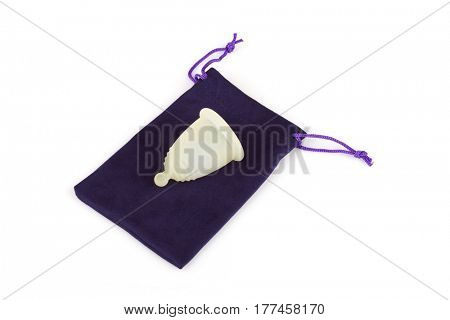 Silicone menstrual cup on a microfiber storage pouch. Menstrual cup is eco-friendly, practical, safe and inexpensive