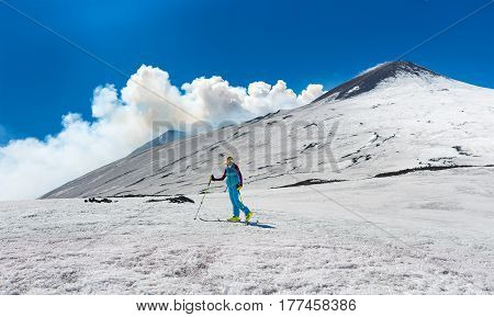 Girl Ski Touring Under The Top Of The Crater Of Mount Etna