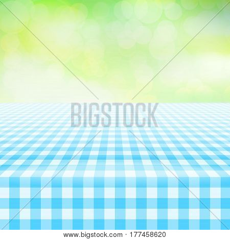 Empty picnic table covered with checkered gingham tablecloth. Blurred green background. Summer picnic background for product presentation Vector illustration. Light blue gingham pattern