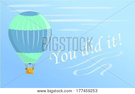 A green and blue hot air balloon flies in the sky. Flies in aerostat