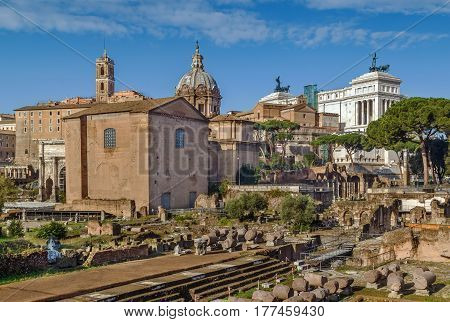 The Roman Forum is a rectangular forum (plaza) surrounded by the ruins of several important ancient government buildings at the center of the city of Rome. Curia and Santi Luca e Martina church