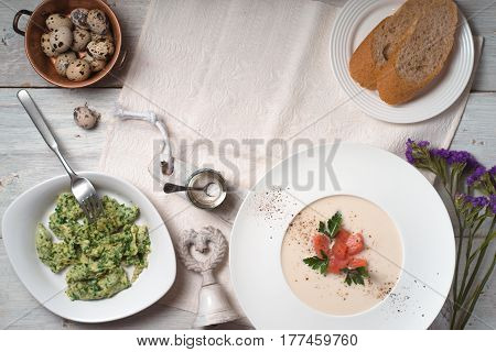 Soup puree with salmon and an omelette on the table cope space horizontal