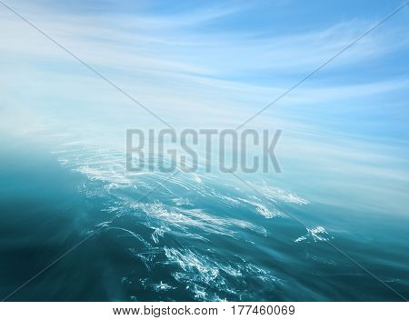 An abstraction of ocean and sky with blurred camera motion.