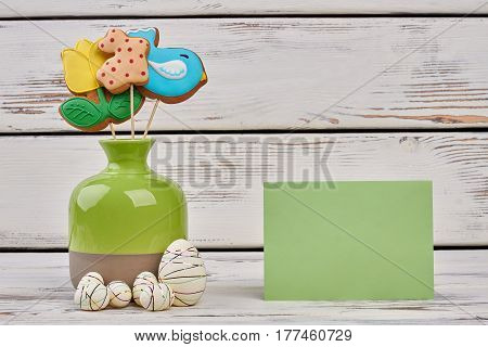 Vase and blank greeting card. Styrofoam eggs on wooden surface. Be kind and wish best.