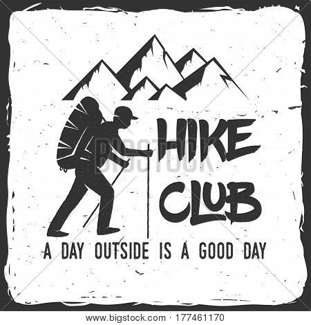 Hiking club badge with text A day outside is a good day. Mountains related typographic quote. Vector illustration. Concept for shirt or logo, print, stamp.