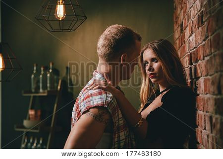 Sexy woman looking at her boyfriend with desire