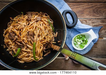 Thai beef noodles with green chili and onions