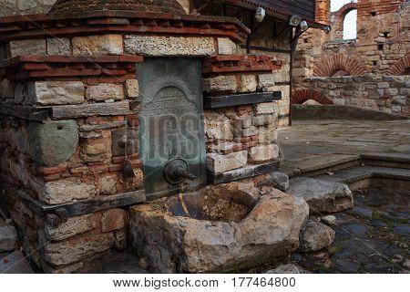 Fountain along the narrow streets of the town of Nesebar, Bulgaria.