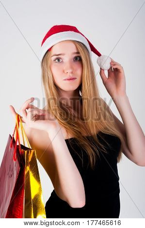 Young attractive woman with christmas hat over white background.