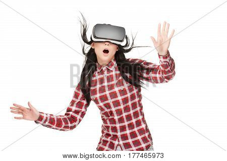 Shocked emotional woman with opened mouth wearing in VR traveling in cyberspace and gesturing by hands. Brunette girl touching by hands and spending time in virtual reality. Wind effect.