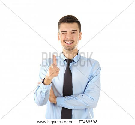 Handsome businessman in elegant suit pointing on white background
